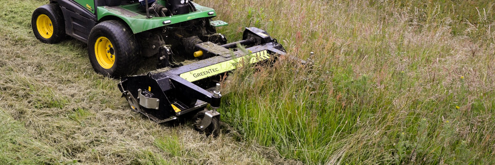 Front mounted flail mower for compact tractors and Municipal vehicles