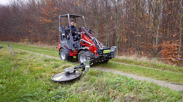 Barrier mower attached to boom mower for skid steer loader