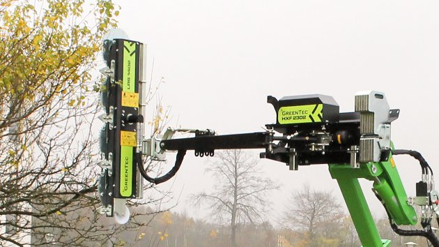Boom mower cuts branches high up in the air