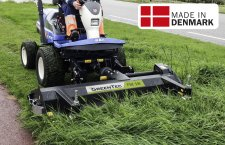 Front mounted flail mower mowing grass near road