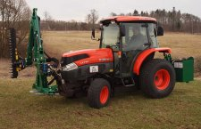 Front and rear mounted arm mower on a compact tractor