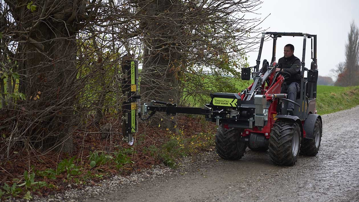Boom mower for skid steer loader and compact tractor