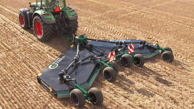 Stubble mulching machine mows a field with stubbles