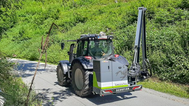 Roadside maintenance with large boom mower