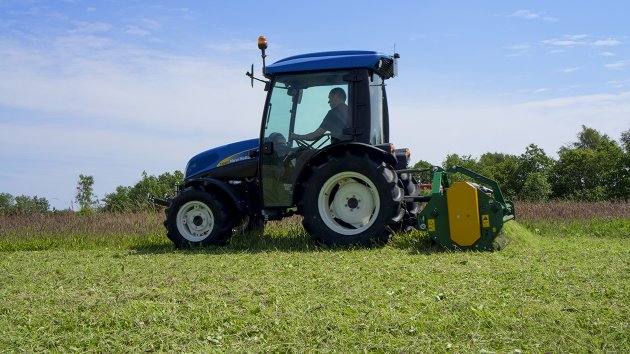 Flail mower pulverizes the grass