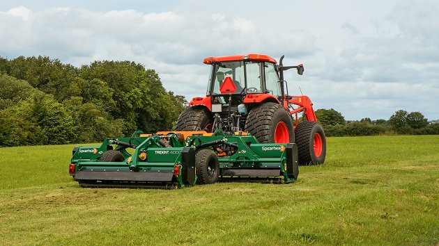 Trailed flail mower mows the lawn