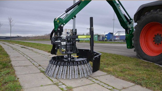 Road brush mounted on tractor