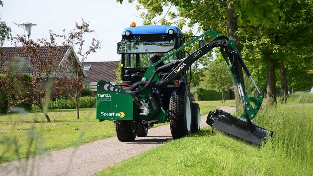 Ditch mower for compact tractor cuts grass