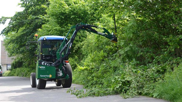 Boom mower for compact tractor cuts the hedge