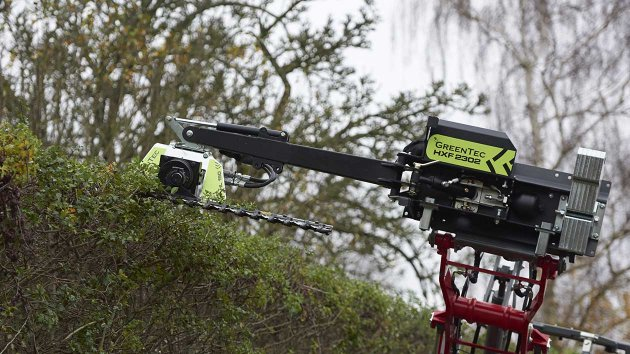 Hedge cutter attached to boom mower