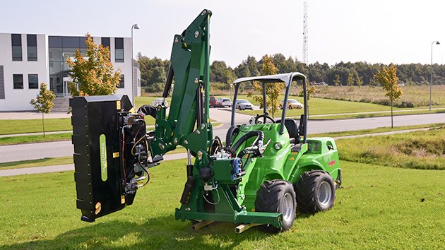 Front mounted arm mower in transport position
