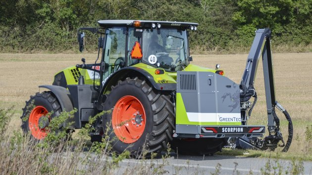 Boom mower mounted on Claas Arion 650 tractor
