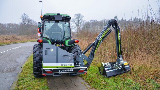 Compact tractor with ditch mower
