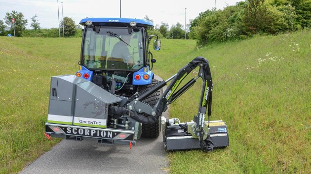 Flail head attached to a boom mower on a New Holland Boomer 50 compact tractor