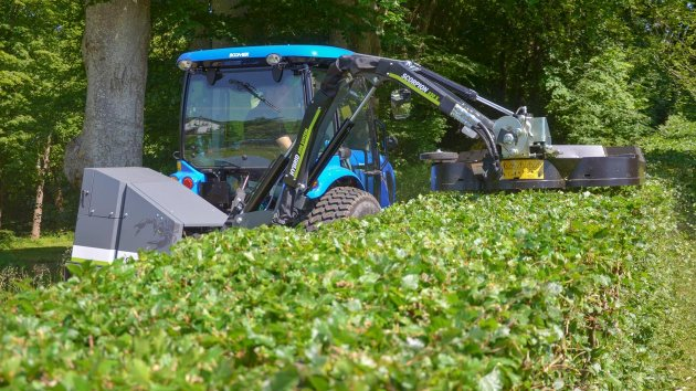 Compact tractor with hedge trimmer attachment