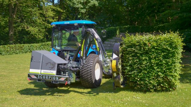 Hedge cutter mounted on New Holland Boomer 50 compact tractor