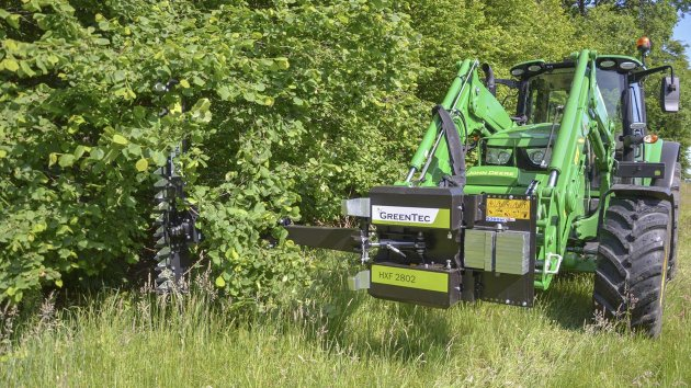Hydraulic hedge trimmer mounted on John Deere 6155M tractor