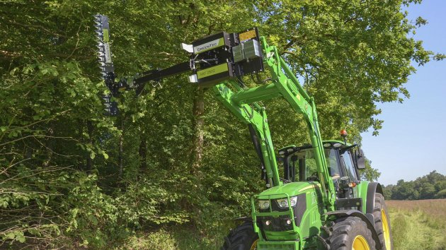 Cutting branches with the extended reach of the front end loader