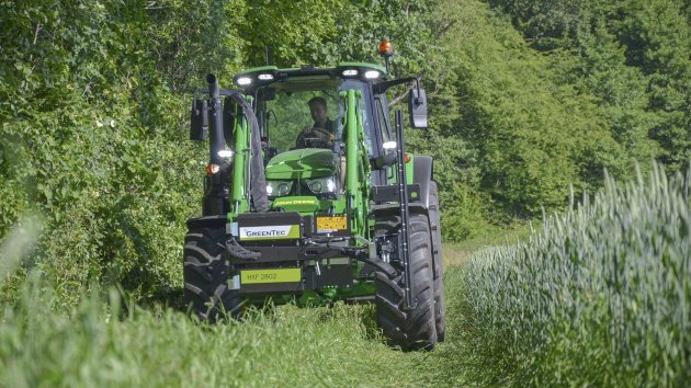 GreenTec Multi Carrier HXF 2802 and attachment tool in transport positon on front end loader