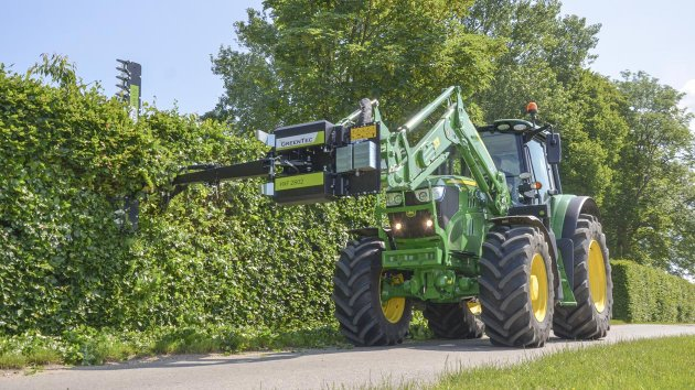 Front end loader attachment for hedge trimming