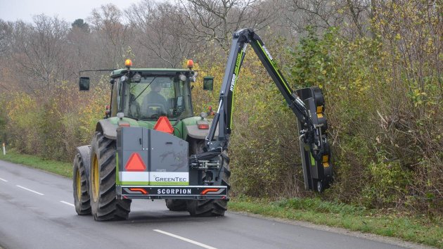 Professional roadside maintenance with hedge mulcher