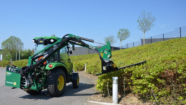 Boom mower cuts hedges
