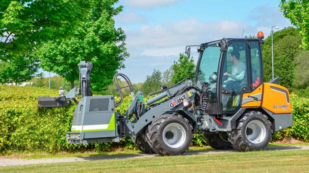 Skid steer with front mounted boom mower