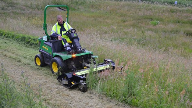 John Deere 1580 with a front mounted flail mower