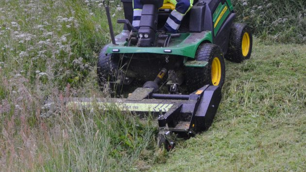 Front mounted flail mower on John Deere 1580 commercial mower