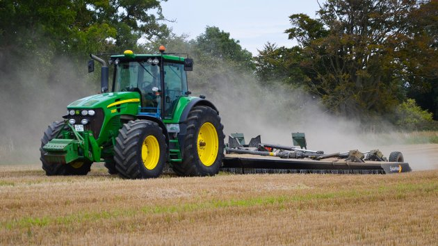 Rotary mower cuts stubbles on a field