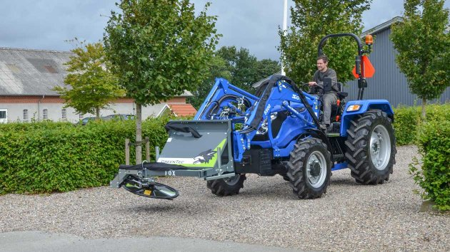 The GreenTec Multi Carrier FOX and Barrier Mower RI 80 in transport position on tractor