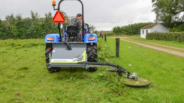 Tractor attachment for mowing under fences