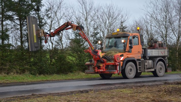Hedge mulcher mounted on Unimog truck