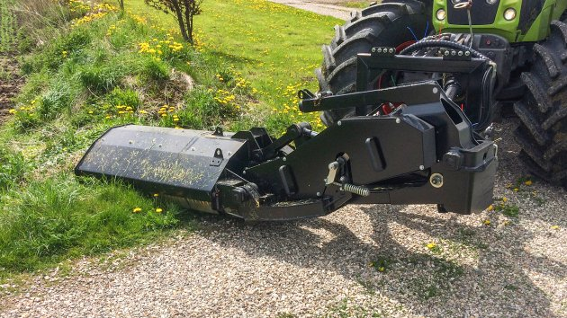 Hydraulic offset flail mower mounted in the front of the tractor
