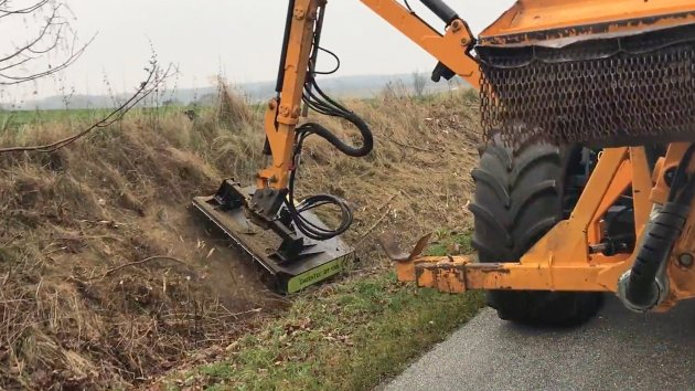 Flail mower head cuts branches on the ground