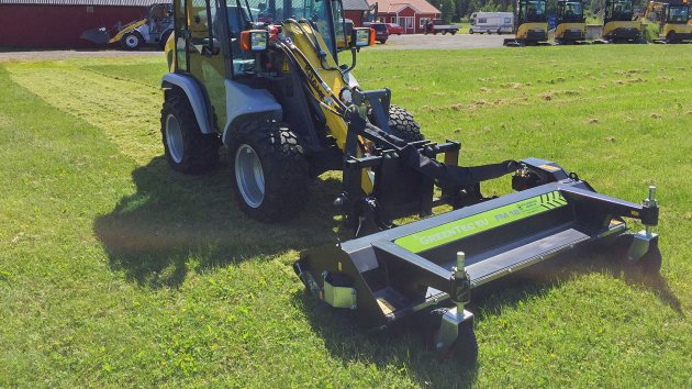 Flail mower mounted on skid steer loader