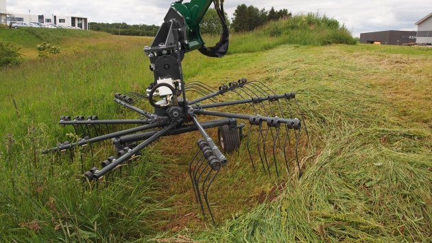 Rotary rake removes cut grass from the ditch