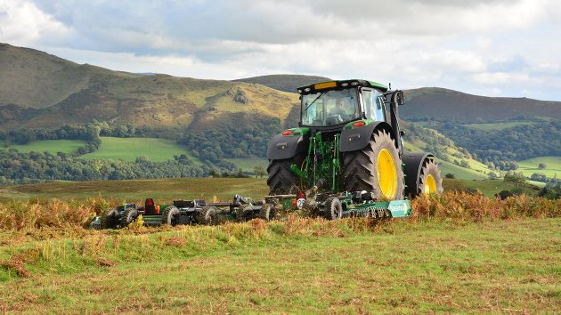 Rotary mower trailed behind tractor