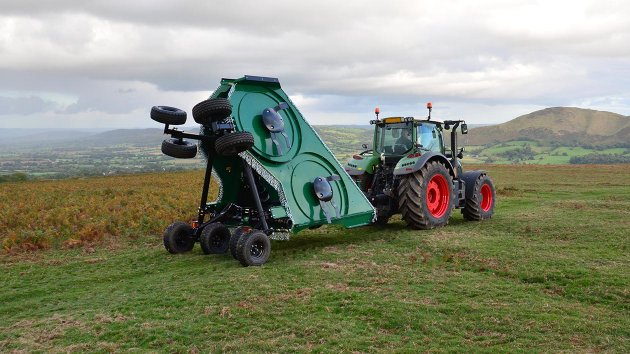 Trailed rotary mower ready for transport with its folded wings