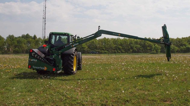 Reach mower with quadsaw stretched out