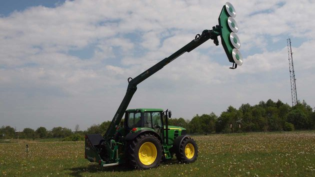 Reach mower mounted on a tractor