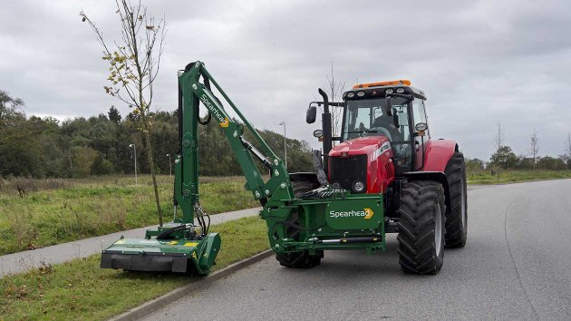 Front mounted verge mower on tractor with an attached flail head
