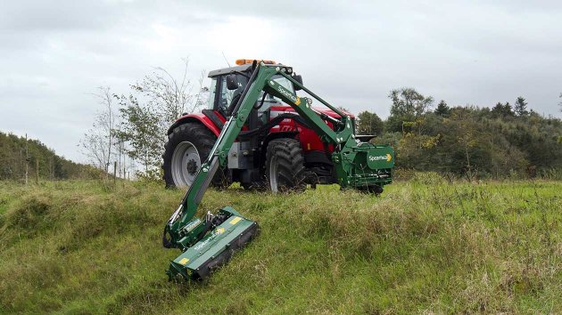 Front mounted reach mower for maintenance of grass in verges