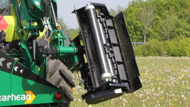 Flail mower attachment in transport position