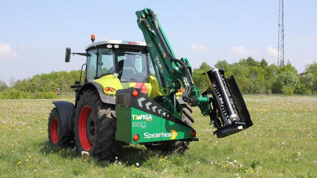 Reach arm mower in transport position