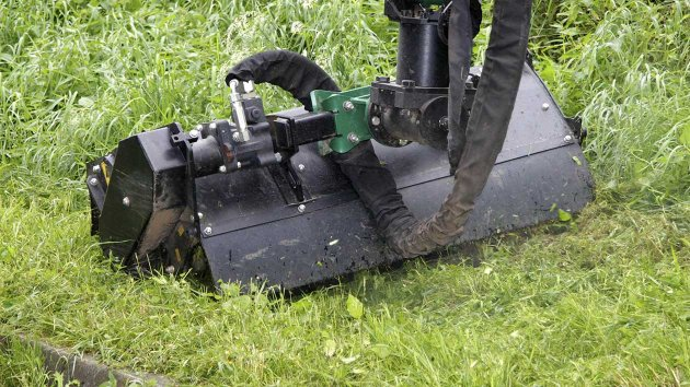Grass mowing with flail mower attachment