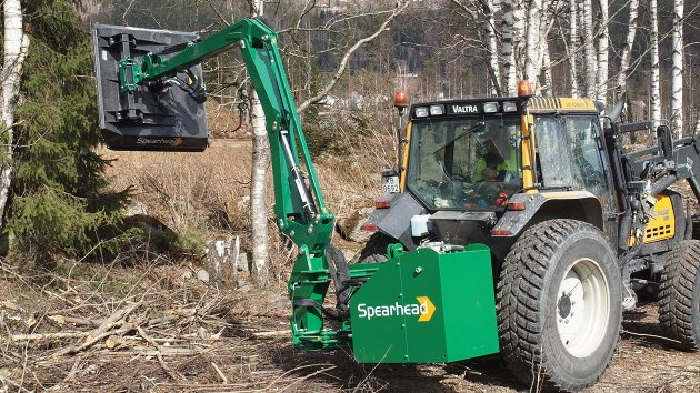 Twiga Flex uses its long reach to mulch branches on the ground