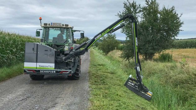 Cutting grass on a slope with a GreenTec Boom Mower Scorpion 730 PLUS
