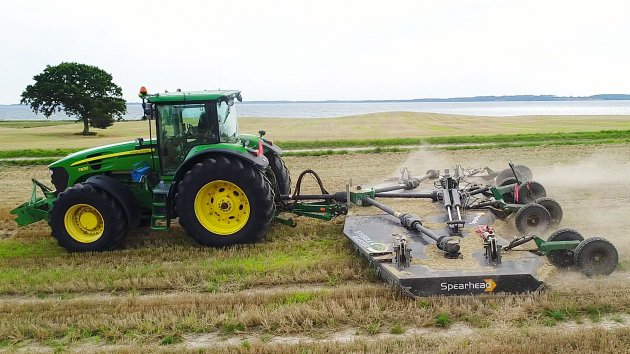 Rotary mulcher for tractor cuts stubbles near ocean
