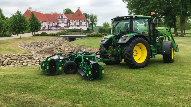 Dry grass gets cut by flail mower